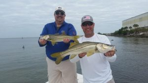 Scott and Dr. M with a couple nice snook